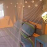 Slaapkamer in Safaritent bij Ecolodge van Glamping4all
