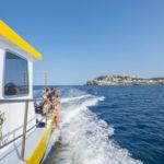 Punta Milà met de boot om te duiken